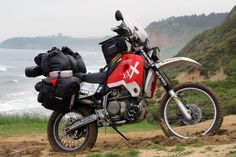 Honda XR650R Round the World Bike - Some of the custom modifications included a heavy duty subframe, custom fabricated pannier rack, stiffer suspension springs, oversized fuel tank, Scottoiler lubrication system, rear fender mounted lithium battery, LED lighting, and a touring windscreen.