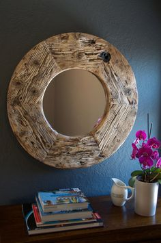 Reclaimed Wood Round Mirror  A medium size mirror made of rustic weathered timber. Unique addition to any space. Home or office. Timber has lots of character with lovely, grain, knots, burn marks and a bolt hole. It measure 790mm round and it is 50mm thick. Weight: 13kg