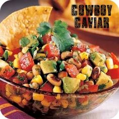 Cowboy Caviar.  Ingredients:  2 cans (15 oz) black beans, rinsed and drained  1 can (17 oz) can whole kernel corn, drained  2 large tomatoes, chopped  1 or 2 large avocados, peeled and diced  1/2 red onion, chopped  1/4 cup chopped fresh cilantro    Dressing    1 Tbsp. red wine vinegar  3-4 Tbsp. lime juice  2 Tbsp. olive oil  1 tsp. salt  1/2 ts...