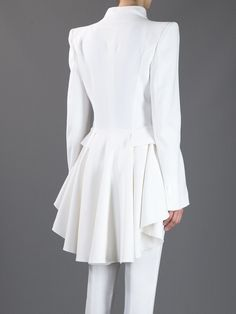 ALEXANDER MCQUEEN - White Dipped Hem Coat:  Ivory crepe coat from Alexander McQueen featuring padded shoulders, v-neck, full length sleeves with button fastened cuffs, two flap pockets to the sides and a pleated dipped back hem. The coat has concealed buttons down the front for closure and is fully lined. €2065