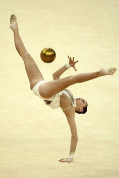Daria Kondakova of Russia performs with the ball during the qualification round of the Rhythmic Gymnastics London 2012 Olympic qualifier, a part of the London Prepares series of test events, at the North Greenwich Arena in London.