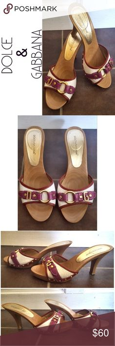 "Dolce & Gabbana Wood Slide Heels Authentic Dolce & Gabbana wood slide heels. Purple, white, and deep red leather with gold metal accents. Has normal wear, scuffs, and markings. Size 39. Heel height from highest point is approximately 3.5"" Dolce & Gabbana Shoes Heels"