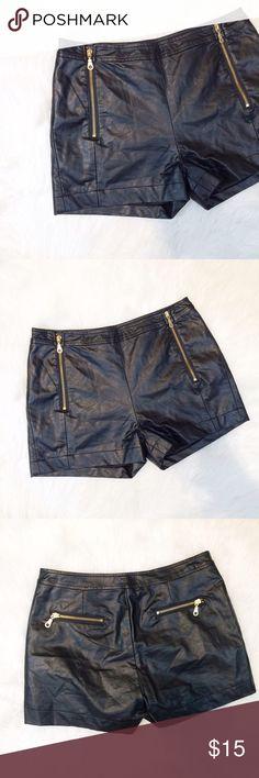 High-waisted Vegan Leather Shorts These Vegan Leather high waisted shorts are super hot and trendy! Size medium, cute zipper details. Waist measures 15 inches, length measures 11 1/2 inches, rise is 2 1/2 inches. Ligali Shorts