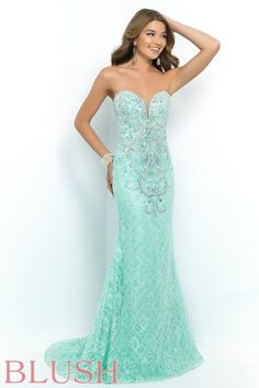 Elegant and sweet! This beauty is constructed of delicate lace and features a plunging sweetheart neckline with modesty panel, a vine like pattern of AB stones and crystals, and a sweeping train. Tailored and form fitting makes this dress a perfect choice for your next evening event! Back zipper closure. Available in Coral, Lilac, and Mint Green.