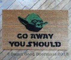 "Yoda themed ""go away"" door mat."