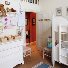 This sweet, galleried play area designed by Trine Miller, has the dual function of creating an adventurous play space, while also keeping toys contained and out of view. 'The idea was that the gallery was very much their private space,' says Trine, 'rather like a tree house.' Beneath, a small bathroom has been installed.