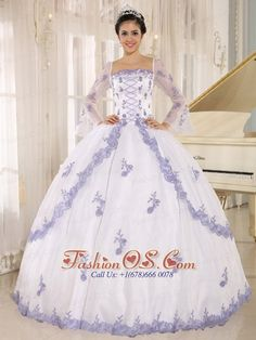 Lilac Embroidery Decorate On White Organza Square Neckline Quinceanera Dress http://www.fashionos.com An all-over exquisite embroidery make this quinceanera gown glamour. It features trumpet sleeves and all the appliques throughout. The full ball gown with floral hemline cascading down the sides and sparsely scattered on the front creating an enchanting effect. The skirt moves graciously with you when you walk, gently sweeping the floor in an old south style.