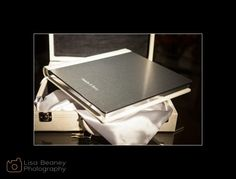 Italian Wedding Albums - Brushed Metal cover with white leather. Names engraved on the front. Album Epoca