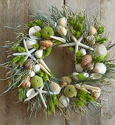 A handcrafted #wreath made with seashells and starfish brings a little bit of the #beach to anyone's home!