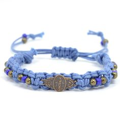 Popular corded style bracelet creates a fun way to wear a Miraculous Medal. The blue cord sets off the bronze medal accented with metal and glass beads. Great Confirmation gift.