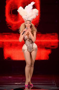 The modern showgirl. Beyoncé wears a spectacular headpiece and bodice created by Ralph & Russo using Swarovski Elements