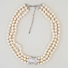 Three Strand Pearl Necklace.