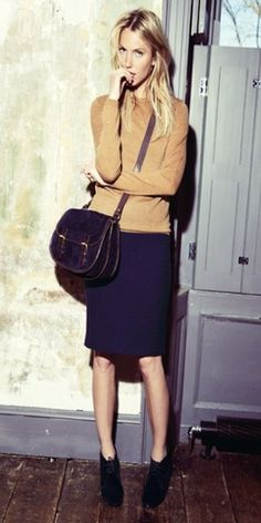 Mix a navy pencil skirt with a camel sweater and high-heeled booties.