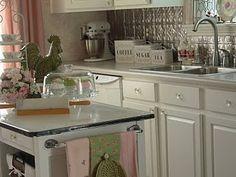 Cottage kitchen makeover - love the crystal knobs & porcelain top island!