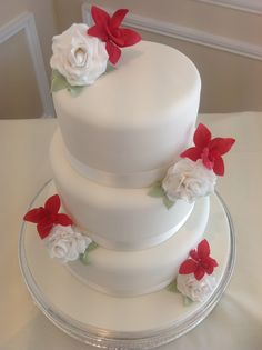 Red orchid and white rose wedding cake