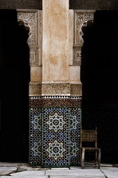 Quranic verses sculpted on Moroccan arches.