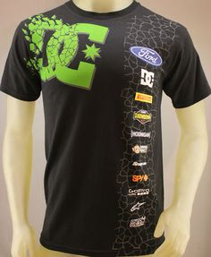 DC Shoes & Ken Block 43 Racing collaboration black T-shirt.  Green DC Shoes logo on front, white Ken Block 43 logo on back, sponsor logos include Ford, Pirelli Tires, Dirt Showdown, Hoonigan, Shining Monkey, Snap On Tools, Spy+, GoPro, AlpineStars & Ryno Power.