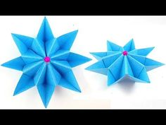 Origami flower that is considerably simple to do. It can even be used as a support for an egg-shaped apparatus.