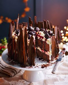 Layers of chocolate sponge, cream and boozy kirsch cherries provide the building blocks for this classic black forest gateau. Chocolate Sponge, Melting Chocolate, Christmas Chocolate, Christmas Desserts, Christmas Cooking, Black Forest Cake, Black Forest Cupcakes, Delicious Magazine, Cake Tins