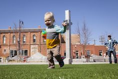 Leo Mickelson, 1, explores the new artificial grass with his grandfather Chris Brady, 54, this week at Main Street Square. The removable turf was installed recently in place of the seasonal sod. Read the story here! #RapidCity #MainStreetSquare #turf #downtownRapidCity