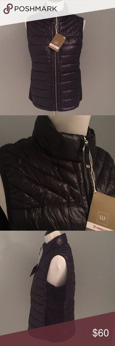 Gap puffy vest Shimmery black puffer vest, NWT. Side panels are a thick stretchy material. GAP Jackets & Coats Vests