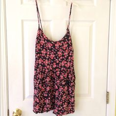 Bethany Mota Floral Romper New! Never worn! Bethany Mota collection from Aeropostale. The romper has pockets and adjustable straps. Aeropostale Dresses