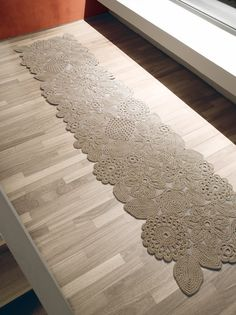 beautiful shown with rug pad underneath?... also would make for an interesting curtain panel or semi-privacy screen?