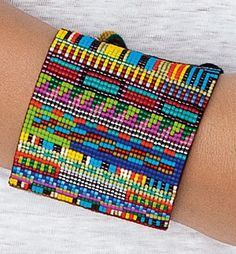 """LARGE RAINBOW BEAD BRACELET  Hand loomed bracelet made with Japanese delicas & nylon thread with sterling silver clasp beads. Adjusts 5 1/2"""" - 8 1/2"""" long, 2 3/8"""" wide. Made by Julie Rofman. $245.00"""