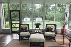 The enclosed porch overlooks the backyard, pool and grounds.