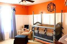 Blue and orange nursery for baby boy.