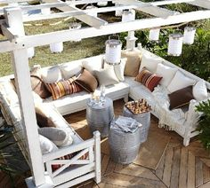 Bench and pergola idea for deck. I like the hanging lights, too.