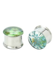 A pair of saddle-shaped plugs with real dried green, blue and yellow flower accents.