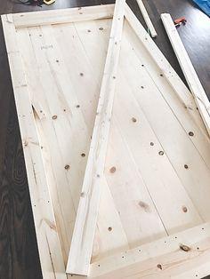 DIY Sliding Barn Door 6 Installing Shiplap, Wood Putty, Diy Sliding Barn Door, Swinging Doors, Door Kits, Bathroom Doors, Wood Glue, Barn Door Hardware, Wood Pieces