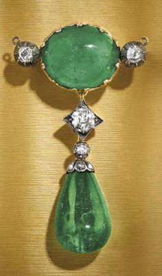 AN ANTIQUE GOLD, SILVER, EMERALD AND DIAMOND BROOCH, CIRCA 1870.