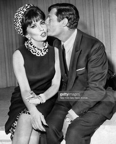Actress Gina Lollobrigida receives kiss from Marcello Mastroianni at Kennedy Airport.