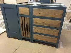 Kitchen island unit painted with rustic plank. Tray pull outs included. BESPOKE AND MADE TO ORDER BY COBWEBS FURNITURE COMPANY.