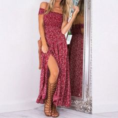 Floral and stretchy, you'll feel the hippie love in this peek-a-boo flowing dress. Bare those shoulders in the strapless design and show off those stems in high slitted style. Hits at the ankle and made with cotton, polyester, and nylon.