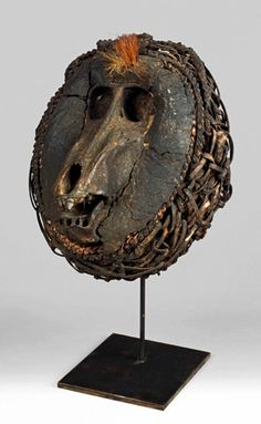 Africa | Reliquary skull from the Vili (Bavili) people; skull, braided wines, clay encrustment and natural fiber