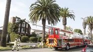 Two Newport Beach police officers and a man were injured during a fire Monday.