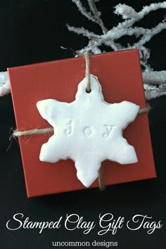 Stamped Clay gift tags for topping holiday gifts by Uncommon Designs