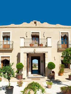 Who knew a converted farmhouse could look so decidedly grand? - The entrance to Casa La Siesta in Andalucia, Spain