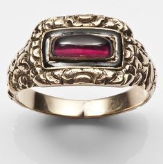 c.1810-20 mourning ring with black enamel and garnet.