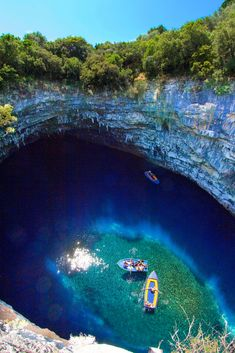 Melissani Lake in Kefalonia, (Greece) is an idyllic place formerly hidden deep in the earth and now filled with brilliant blue water from an underground current which mysteriously flows right under the island.