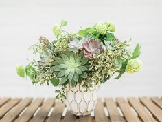 A textural arrangement with succulents and a variety of greens