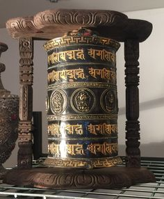 """Large antique prayer wheel from Kathmandu, Nepal. Inside are hand written papers with the mantra """"Om mani padme hum"""" written many thousands of times"""