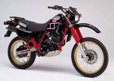 1984 YAMAHA XT600. This is one of my favourite 600cc dirt bikes of all time. I love the overall design, including the frame mounted rear footpegs, but especially the red/black colour scheme with the gold wheels. Just a nice looking bike..
