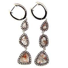 Diamond slice earrings set in blackened gold... wow!