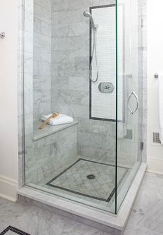 Walk-in showers are a practical, attractive choice for bathrooms large and small. Create a gorgeous walk-in shower with our tips on tile treatments, lighting, layout, storage, and more. #walkinshower #walkinshowerideas #bathroommakeover #showerideas #bhg Shower Floor Tile, Bathroom Floor Tiles, Tub Tile, Shower Walls, Marble Tiles, Bath Shower, Carrara Marble, Bathroom Chair, Bathroom Mirrors
