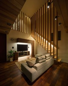 House is a private residence designed by Architect Show Co. in It is located in Hasami, Nagasaki, Japan, and makes extensive use of differently-toned wood to link the different spaces of the home. Photos courtesy of Architect Show Co. Home Stairs Design, Railing Design, Interior Stairs, Stair Railing, Home Interior Design, Wall Design Outside House, Luxury Interior, Stair Design, Loft Design
