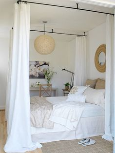 Not this extreme and only at the head of the bed. Keeping the curtains both light in material and color (sheer, lace). To add a little privacy between the two beds.   Ikea has cheap ceiling mounted rails.